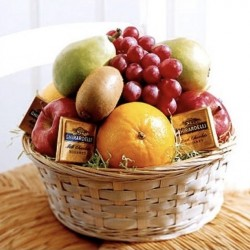 BASKET WITH TEA AND FRUITS